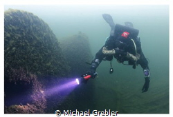 Rebreather diver at the boilers of the wreck of the Rothe... by Michael Grebler